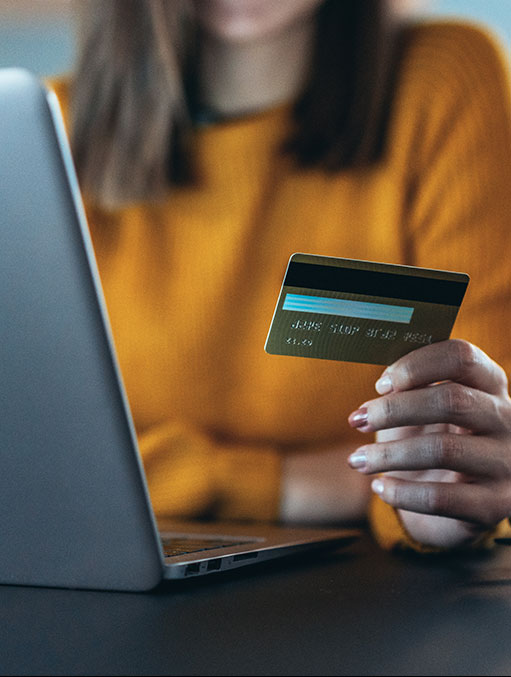 online-payment-women-holding-credit-card-at-computer